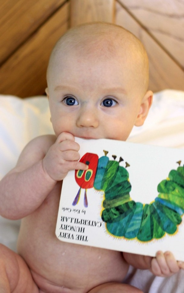 baby eating the very hungry caterpillar