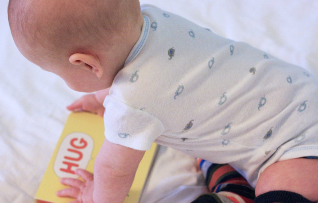 baby with hug book